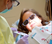 photo of child with dental student